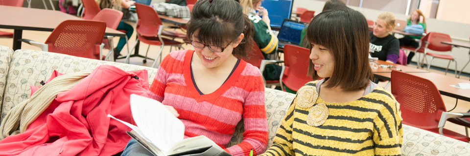 international students studying together at the library