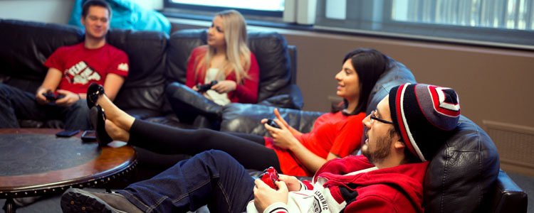 Mentors and students relaxing on a couch